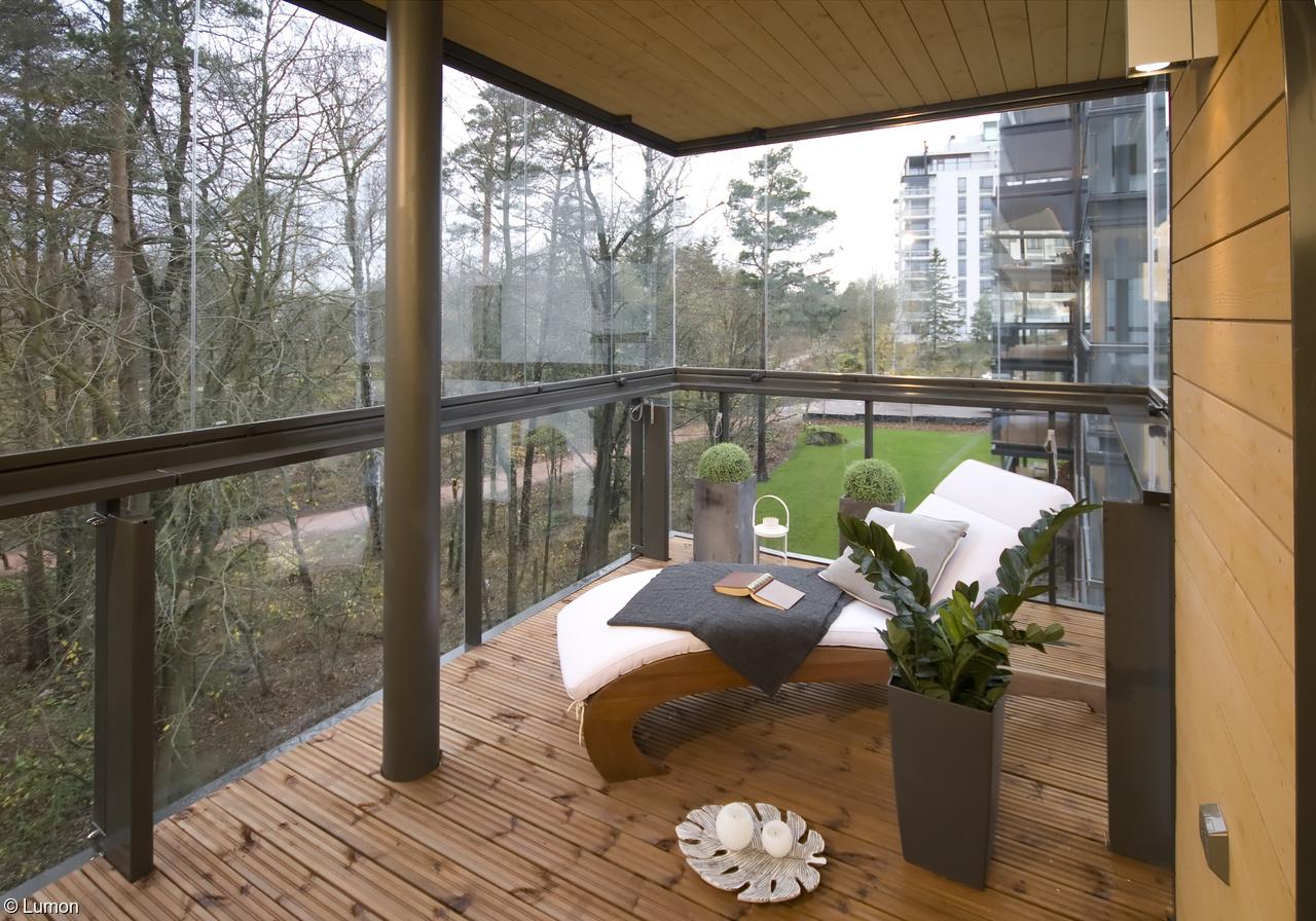 Безрамное остекление лоджий и балкона.