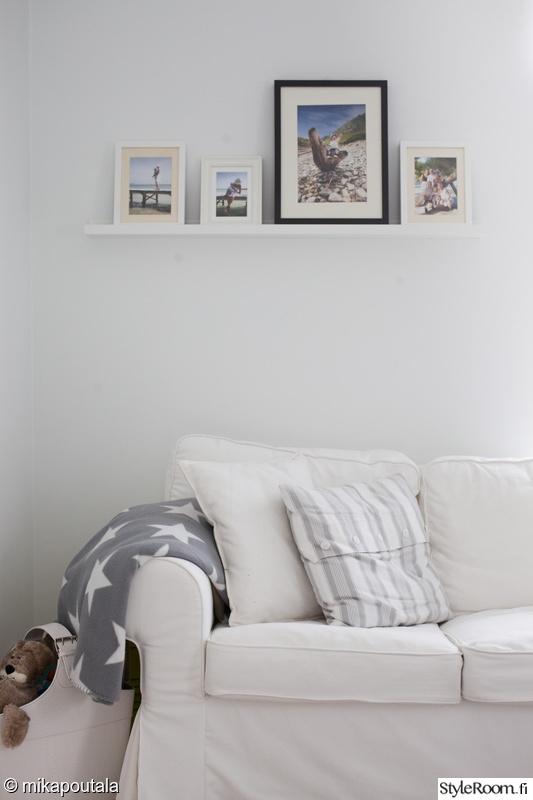 tyyny,valkoinen sohva,tähti,sisustustyyny,valokuvaseinä