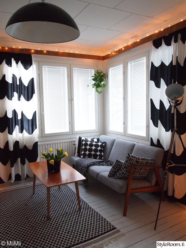 matto,jouluvalot,sohva,marimekko,sohvapöytä